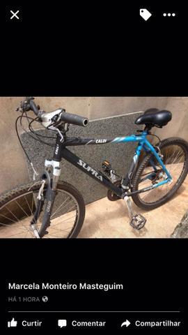 Vendo bicicleta Caloi alumínio boa para tril