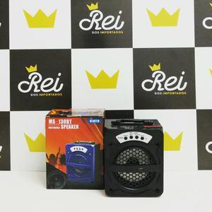 Caixa de som com bateria recarregável e entrada de áudio