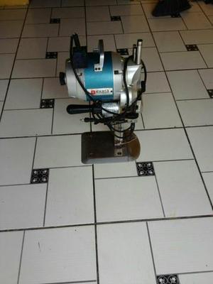 Máquina de cortar tercido