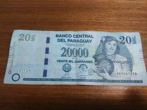Cédulas e moeda do Paraguai Guarani -  e 20 mil