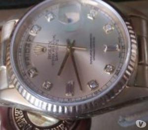 relógio marca Rolex modelo presidente em ouro com