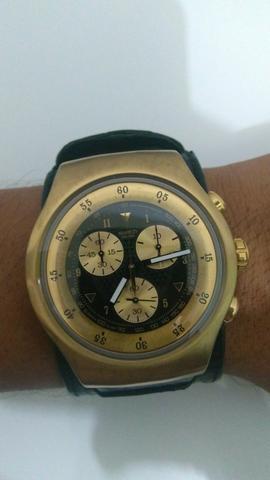 2b1f691e9b3 Swatch série ouro seminovo pulseira couro