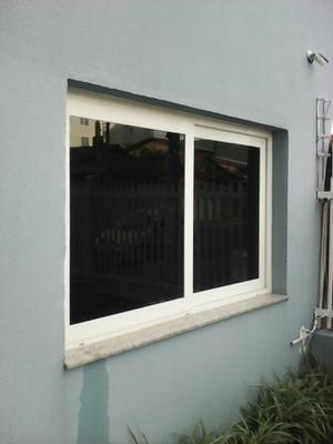 Aplicação de insulfilm em portas e janelas