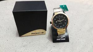 Relógio mormaii dourado zero na caixa