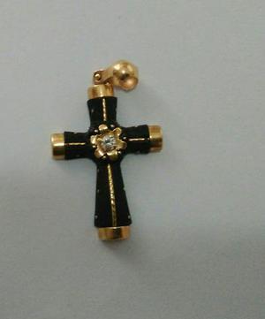Vende-se crucifixo de ouro e coco