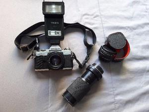 Câmera fotográfica Prof. Minolta X-370 + acessórios.