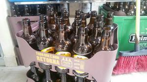 Engradado de cerveja skol, garrafa 300 ml
