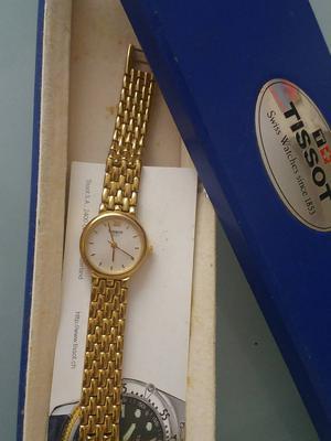 Relógio feminino dourado Tissot