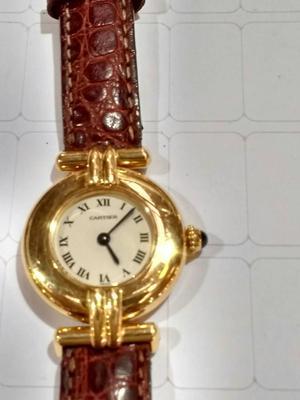 relógio marca Cartier modelo golgar ouro