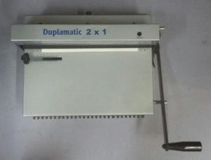 Máquina manual para encadernação
