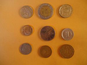 Lote de 9 moedas estrangeiras