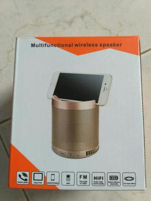 Caixa de som via Bluetooth e suporte de celula