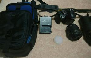 Câmera Nikon D com lente extra