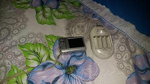 Máquina fotográfica com carregador