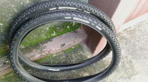 Par de pneus aro 26.$50