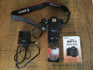 canon rebel t3i + lente canon ef-s mm + grip