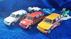 Lote com 3 miniaturas de rovers com reboques 2 com motos e 1