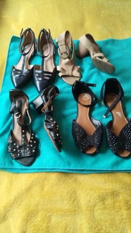 4 pares de sapatos usados