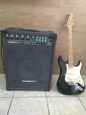 Caixa de som amplificada e guitarra