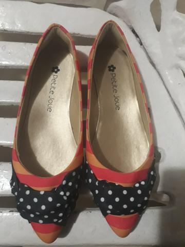 Sapatos ponta de estoque