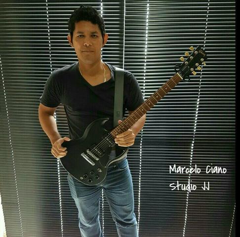 Aulas de Violão e Guitarra (Guitar Player Escola de
