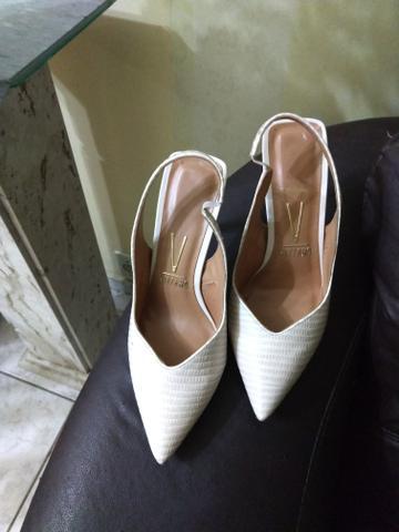 Treis pares de sapatos de marca