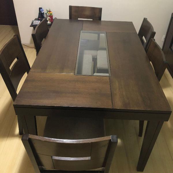 mesa de jantar de 6 lugares com 6 cadeiras e meio de vidro