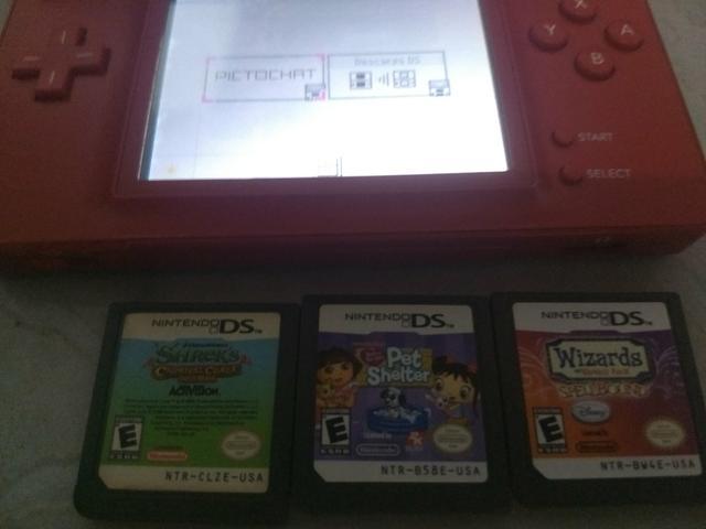 Nitendo DS Lite, com 3 jogos, troco