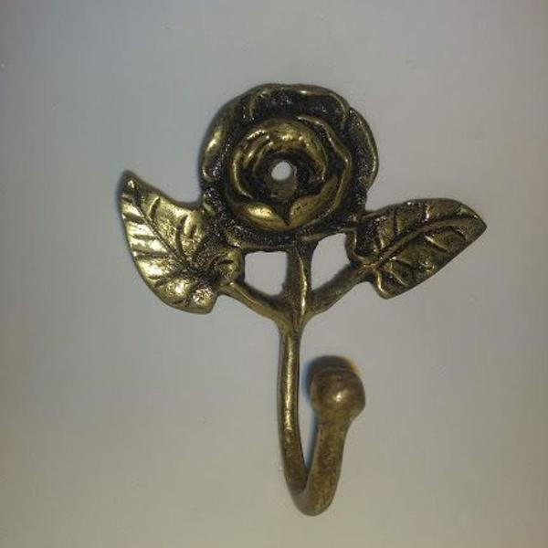 aplique de parede em flor em bronze com furo central