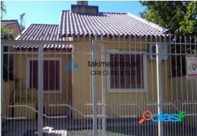 Casa com 3 dormitórios à venda, 69 m² por R$ 190.000
