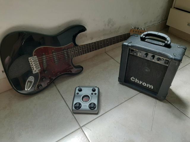 Guitarra + Amplificador + Pedal de efeitos