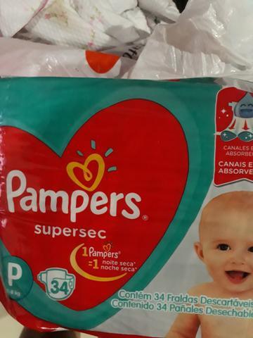 Vendo 3 pacotes de fraldas descartáveis Pampers P