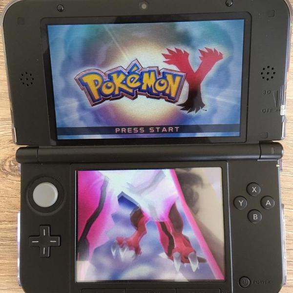 nintendo 3ds xl + 2 jogos + case original do pokémon center