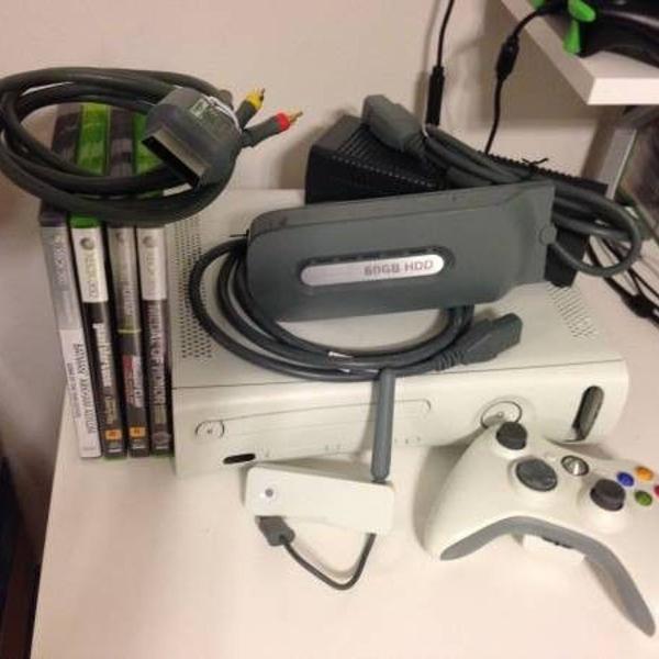 console xbox 360 com 55 jogos originais + kinect + caixa