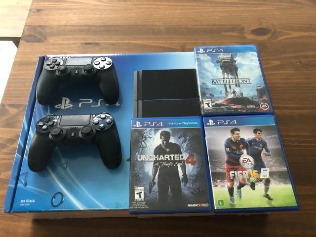 Playstation 4 com 2 Controles e 3 Jogos - Super Novo