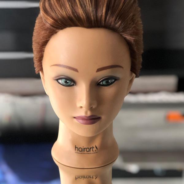 cabeça de boneca