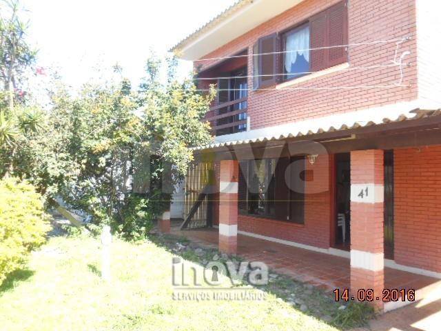 Casa com 04 dormitórios Centro Tramandaí